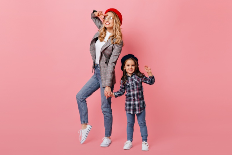 Fashionable Mother Daughter Jeans Pink Background