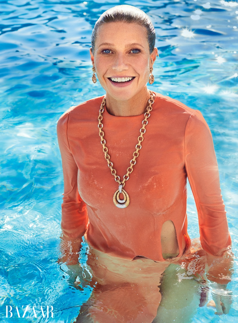 Taking a dip, Gwyneth Paltrow poses in Gucci dress with Van Cleef & Arpels jewelry
