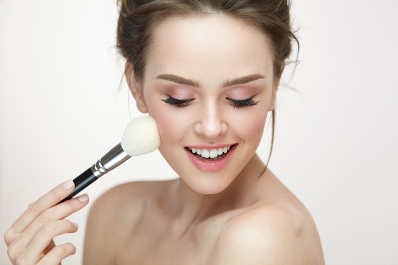Model Applying Makeup Brush Beauty