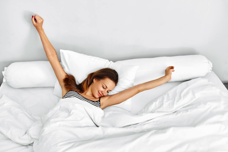 Refreshed Woman Waking Up Bed