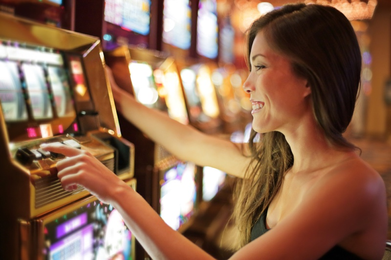 Smiling Asian Young Woman Playing Slots