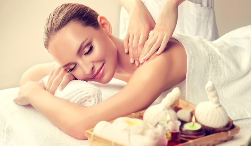Smiling Blonde Woman Massage Candles