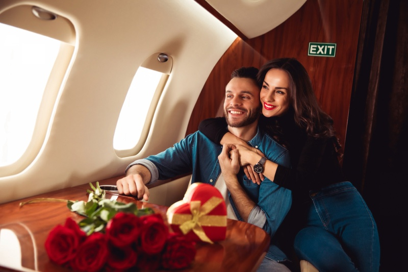 Smiling Couple Plane Roses Heart-Shaped Box