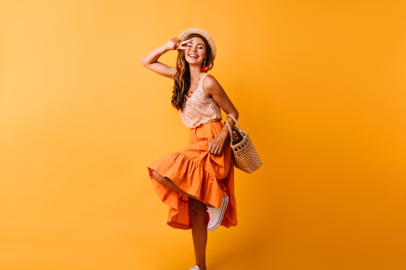 Smiling Model Orange Top Skirt Outfit
