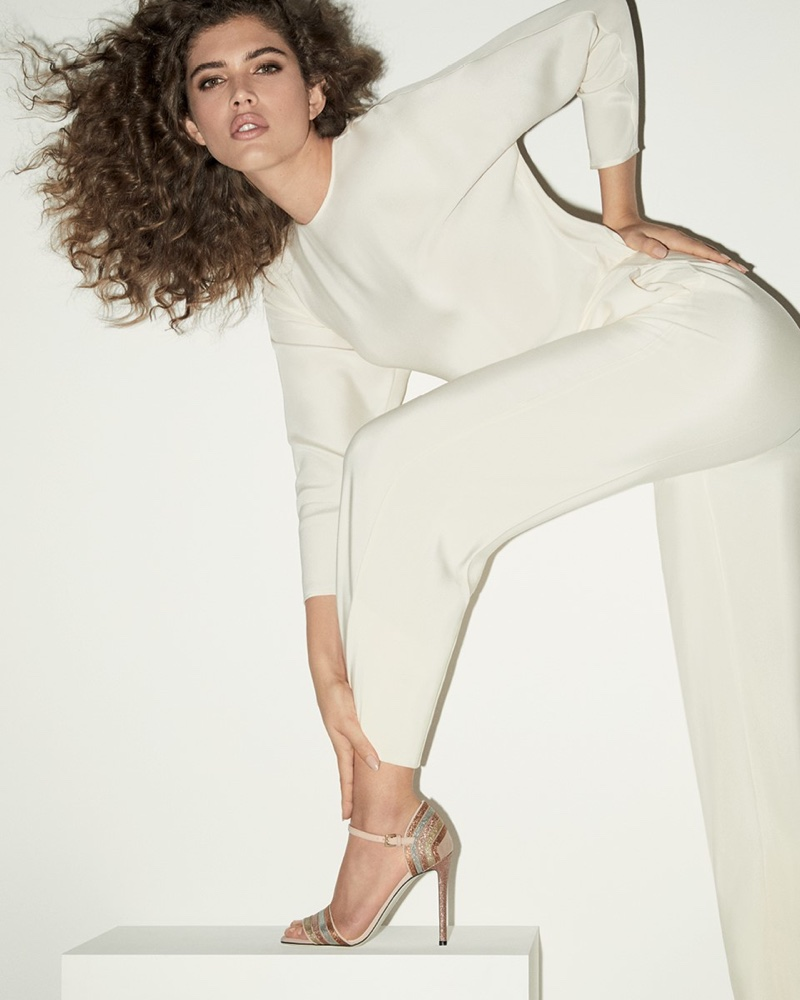 Dressed in white, Valentina Sampaio appears in Pollini spring-summer 2020 campaign