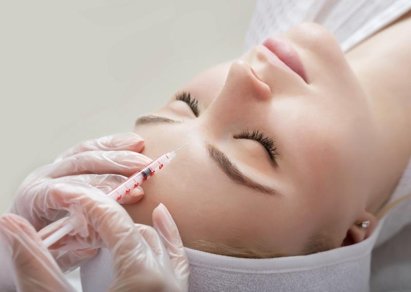Woman Getting Botox Injection Needle