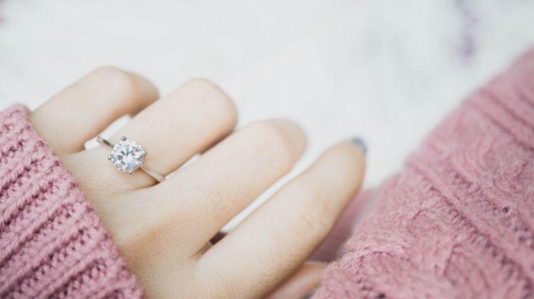 Woman Pink Sweater Diamond Engagement Ring Hand