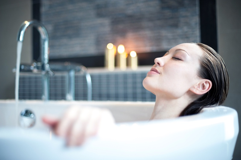 Woman Relaxing Bath Candles Wet Hair