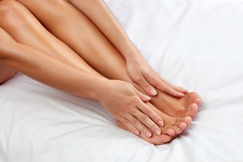 Woman Touching Smooth Legs