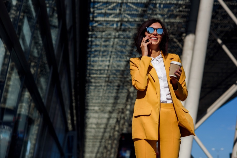 Woman Wearing Yellow Suit Smiling Phone Sunglasses