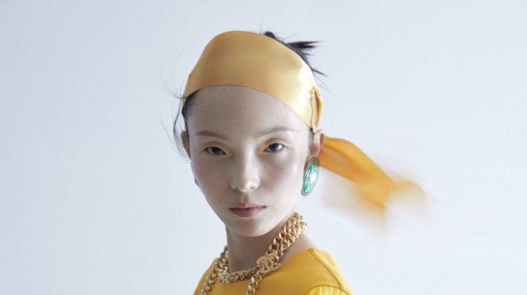 Xiao Wen Ju Poses in Elegant Ensembles for ELLE China