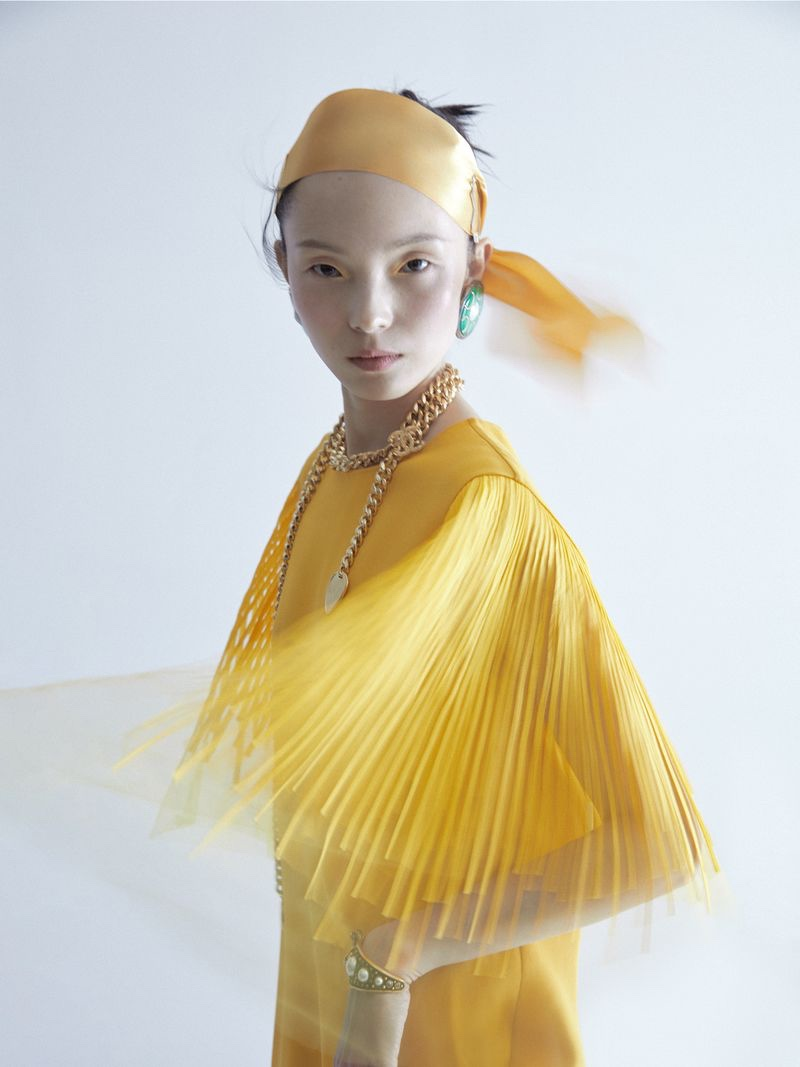 Xiao Wen Ju Poses in Elegant Ensembles for ELLE China
