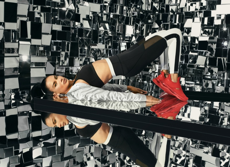 Supermodel Adriana Lima wears red sneakers from PUMA LQD Cell Shatter Mid line