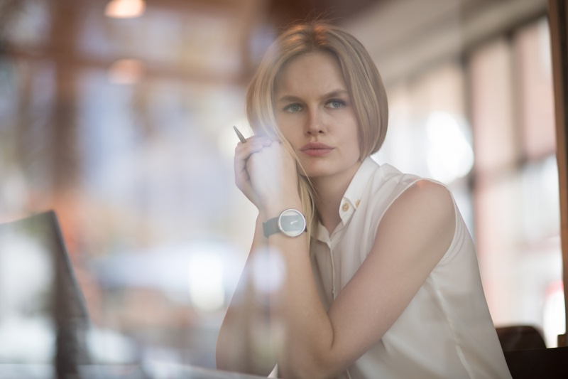 Attractive Blonde Woman Thoughtfully Looking Out Window