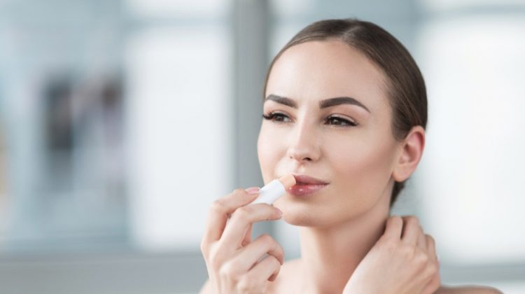 Attractive Woman Applying Lip Balm Stick Beauty