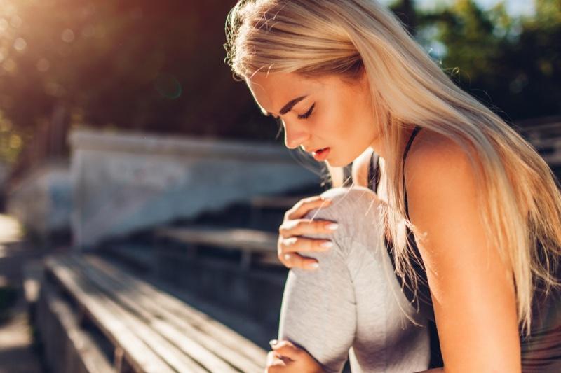 Blonde Woman Leg Pain Workout Clothes