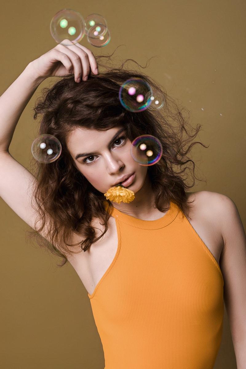 Brunette Model Neon Orange Top