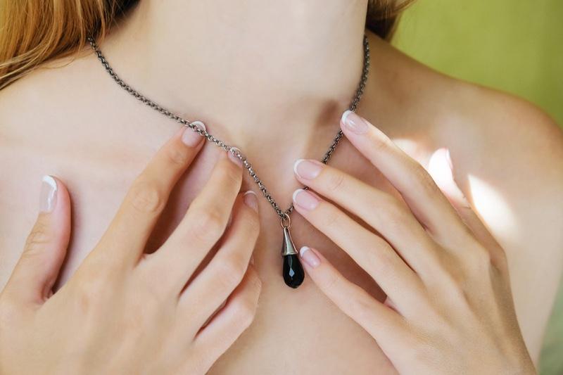Closeup Woman Necklace Pendant Hands