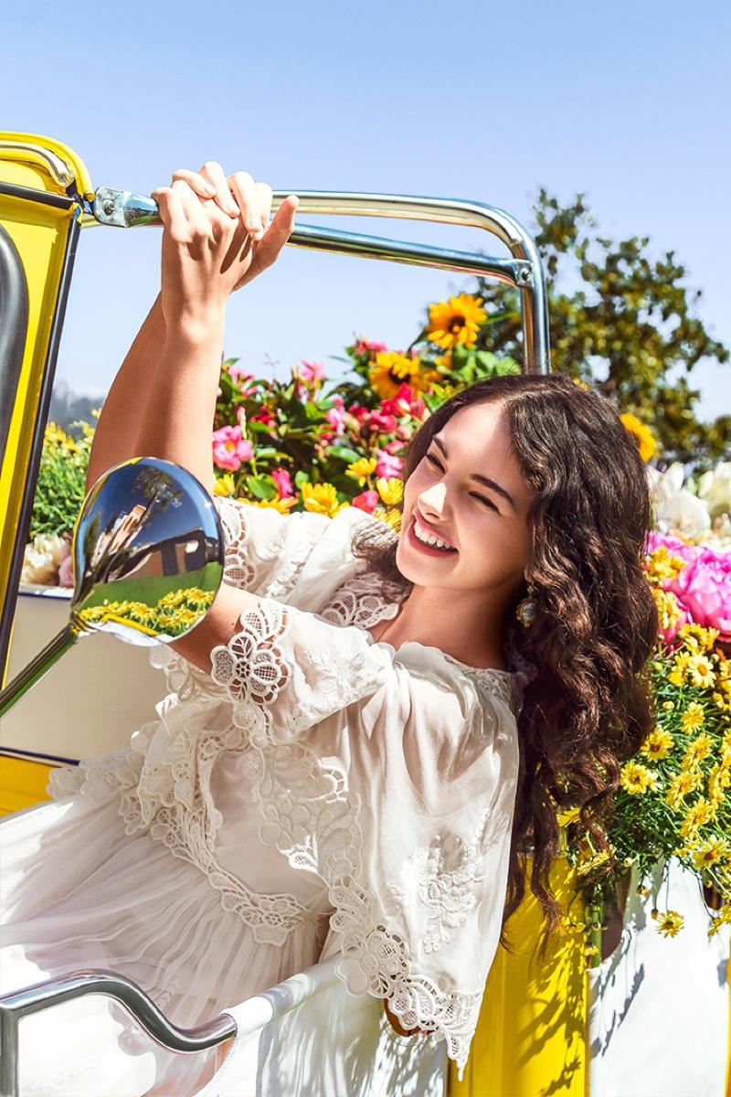 All smiles, Deva Cassel poses on set of Dolce & Gabbana Shine fragrance shoot