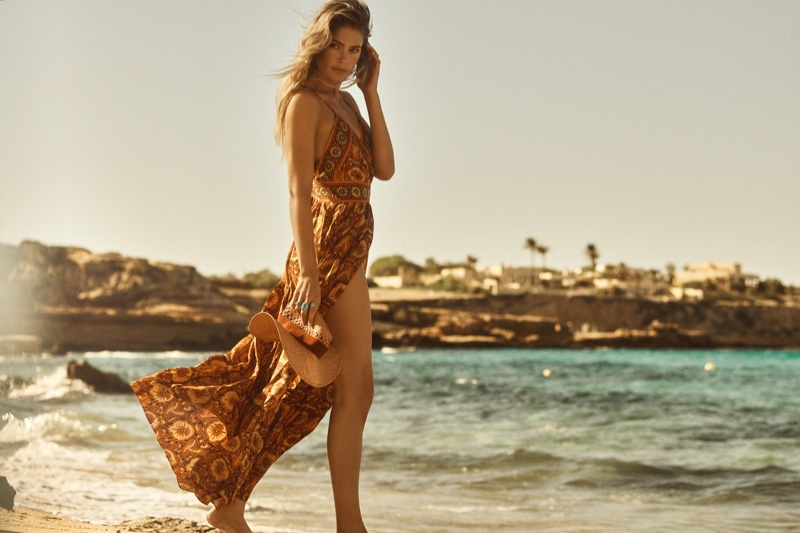 Model Doutzen Kroes poses on the beach for ba&sh spring-summer 2020 campaign