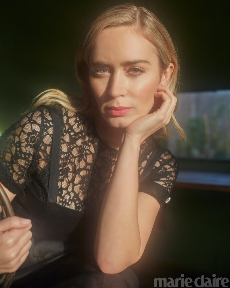 Emily Blunt poses in black lace Chanel dress