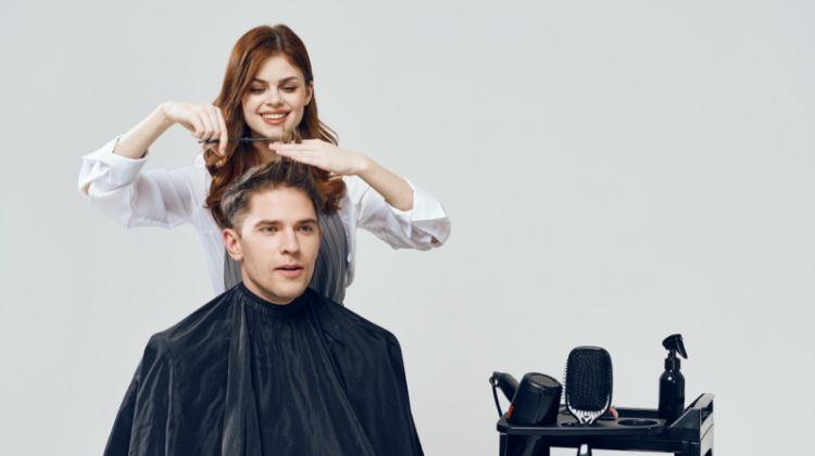Female Model Cutting Male Model's Hair Salon Concept