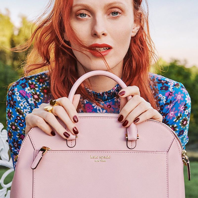 Model Karen Elson poses with pink bag in Kate Spade spring-summer 2020 campaign