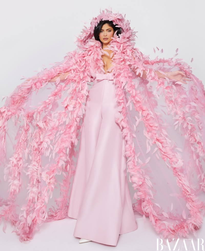 Looking pretty in pink, Kylie Jenner wears Valentino Haute Couture cape and jumpsuit