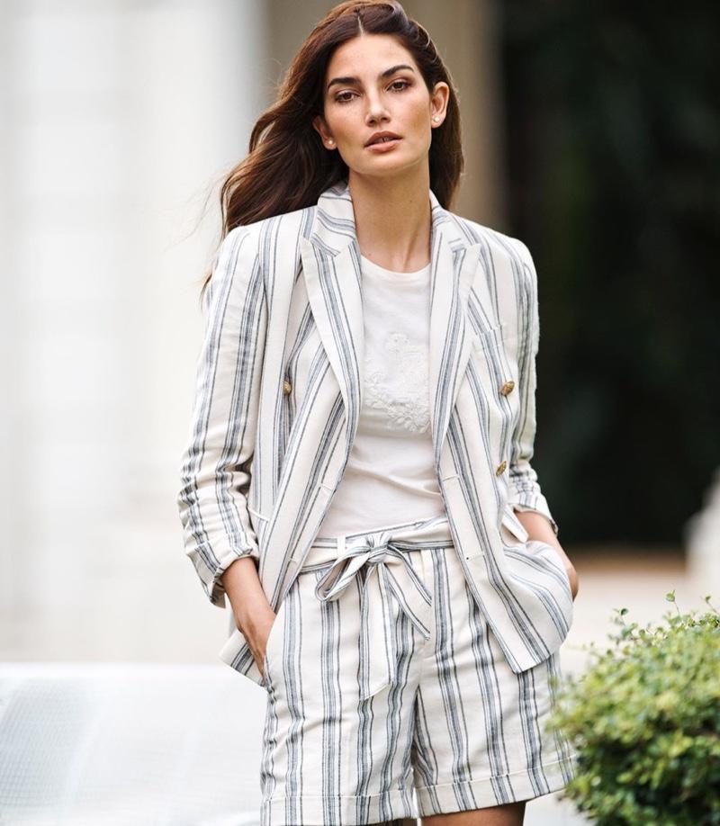 Wearing stripes, Lily Aldridge poses in Lauren Ralph Lauren spring 2020 campaign.