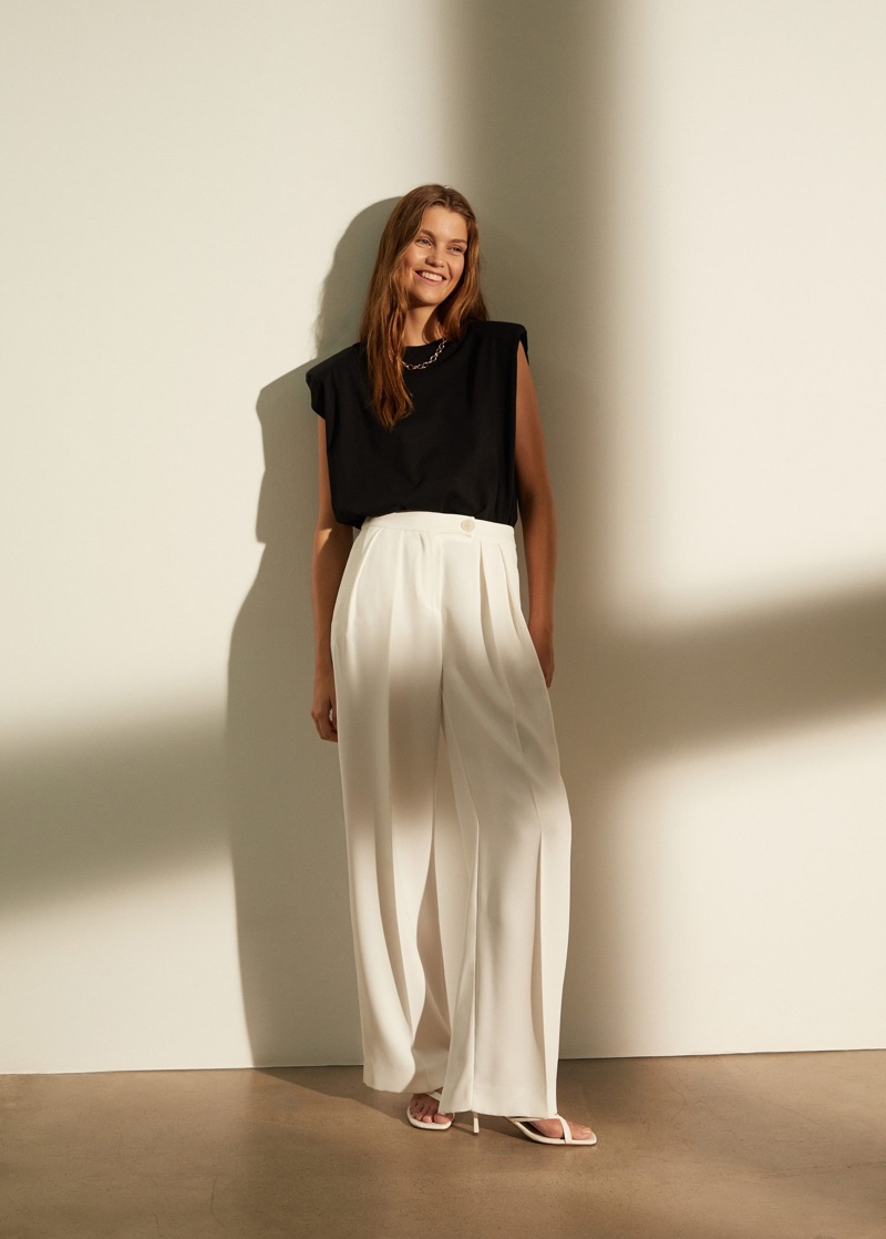 Luna Bijl wears Mango sleeveless top and palazzo trousers