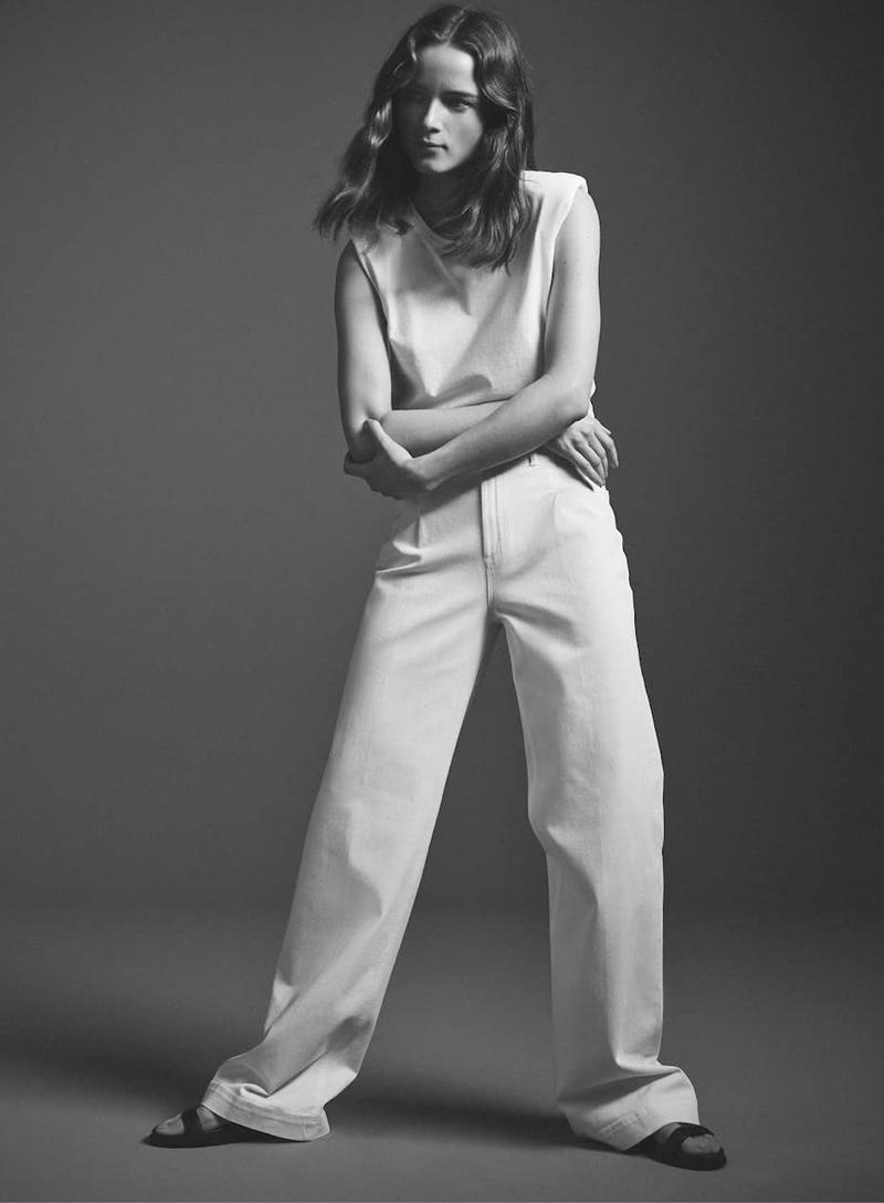 Dressed in white, Anna de Rijk models Massimo Dutti's spring styles