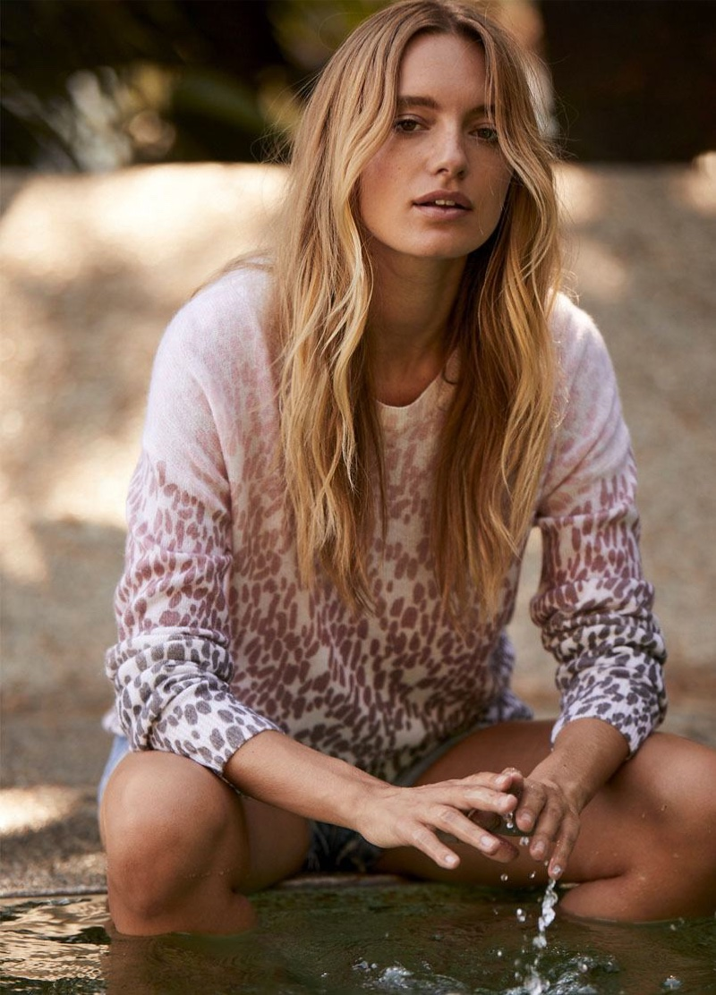 Model Maya Stepper poses in Izzy pullover sweater from 360 Cashmere