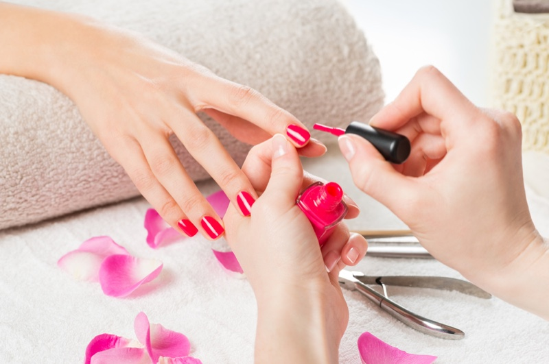 Model Nails Painted Pink Salon