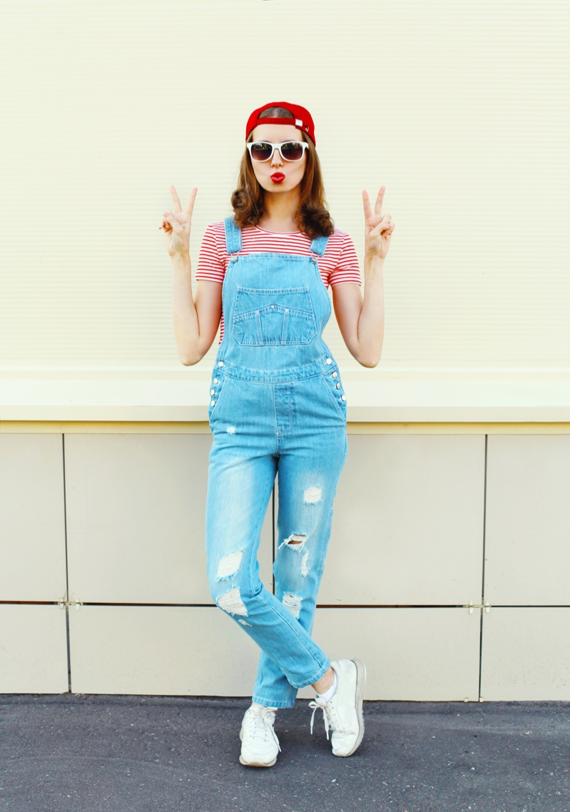Redhead Woman Distressed Overalls Striped T-Shirt