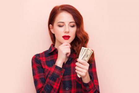 Redhead Woman Plaid Shirt Cash Hand