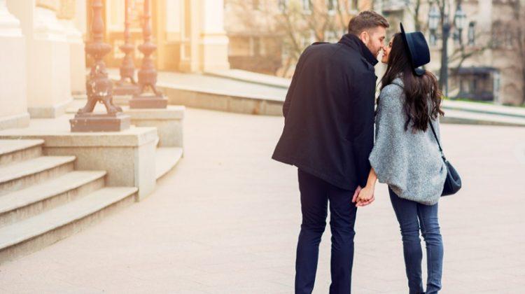 Stylish Couple Holding Hands