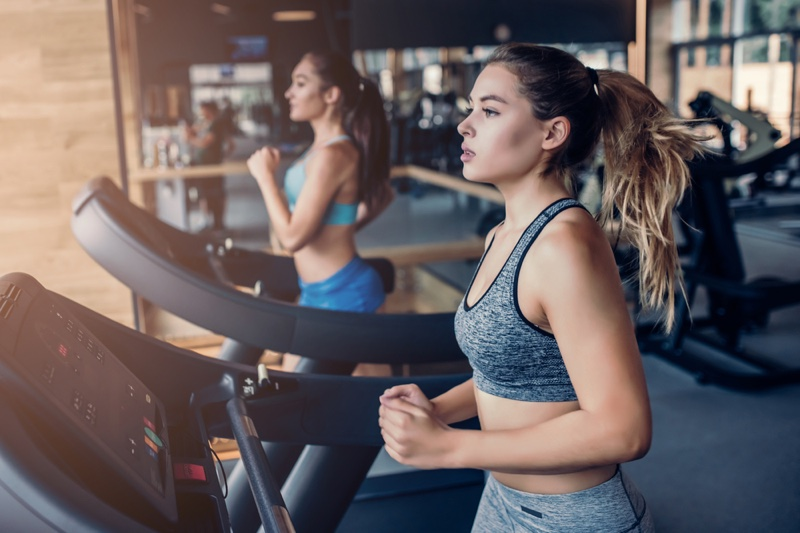 Two Women Running Treadmills
