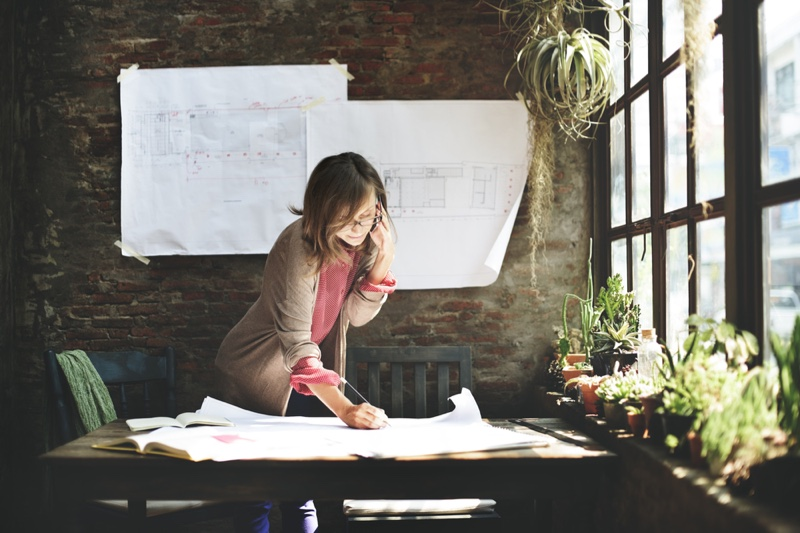 Woman Building Plan Sketches Office