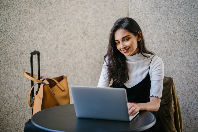 Woman in Layers on Laptop