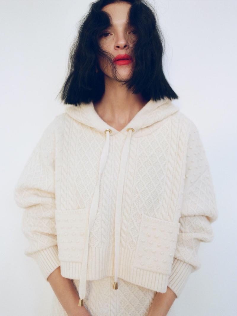 Mariacarla Boscono wears Zara cable-knit sweatshirt and cable knit skirt