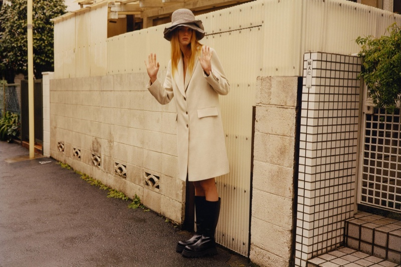 Rianne van Rompaey poses in Zara rustic menswear coat and leather lug sole boots