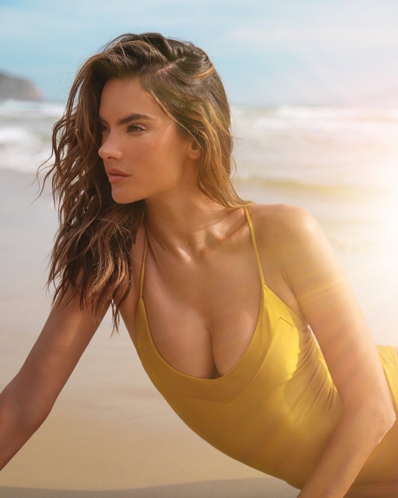 Shining in gold, Alessandra Ambrosio models Gal Floripa Yantra one-piece swimsuit