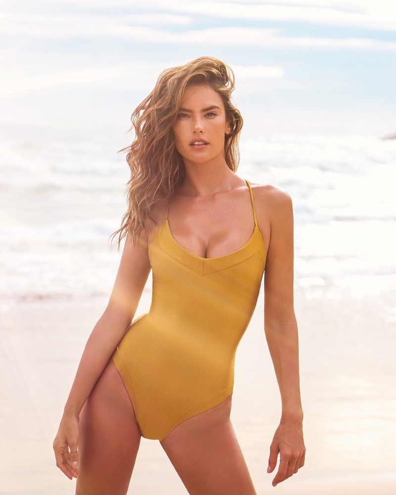 Looking like a golden goddess, Alessandra Ambrosio poses for Gal Floripa swimwear line