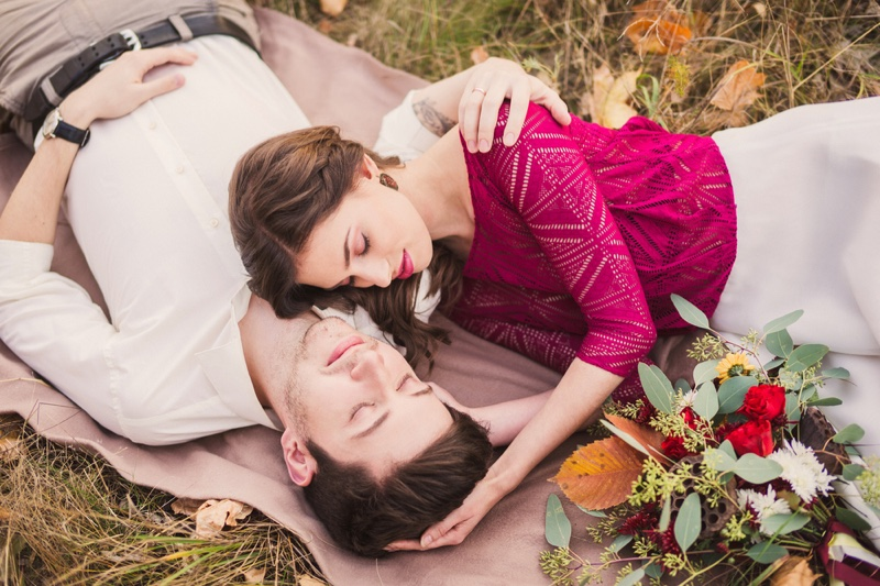 Attractive Couple Laying Grass Embrace Romantic Flowers