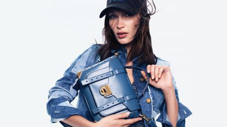 Model Bella Hadid poses in denim for MICHAEL Michael Kors spring-summer 2020 campaign