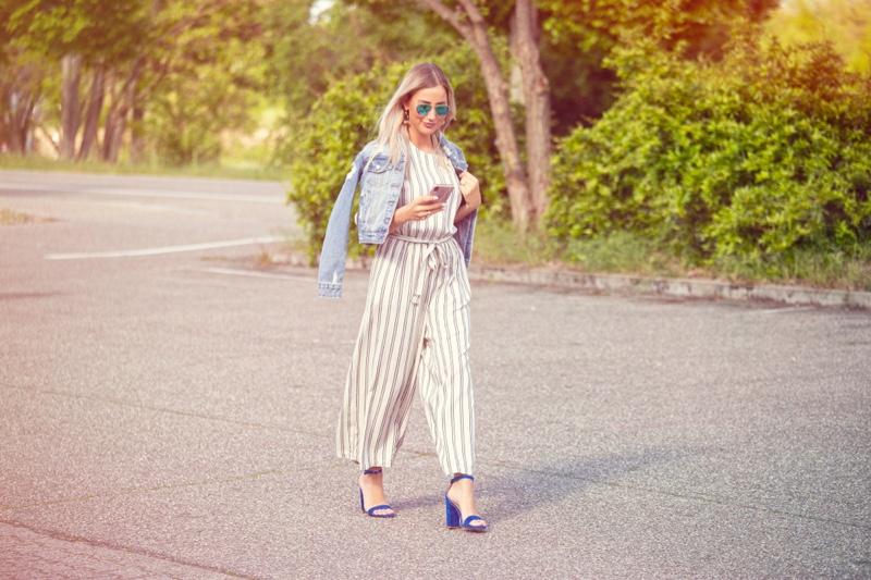 Blonde Woman Wearing Denim Jacket Striped Jumpsuit Sandals