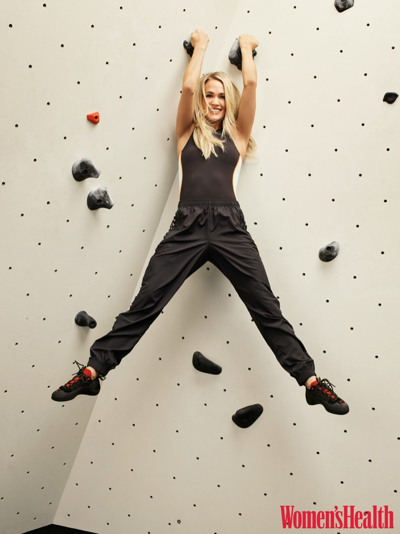 Making the climb, Carrie Underwood wears P.E Nation one-piece, Adam Selman Sport pants and La Sportiva climbing shoes