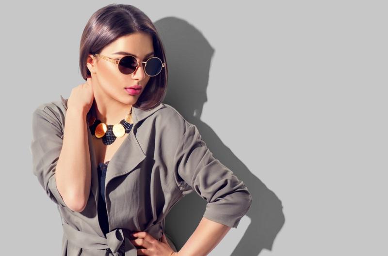 Dark Haired Model Sunglasses Necklace Jacket
