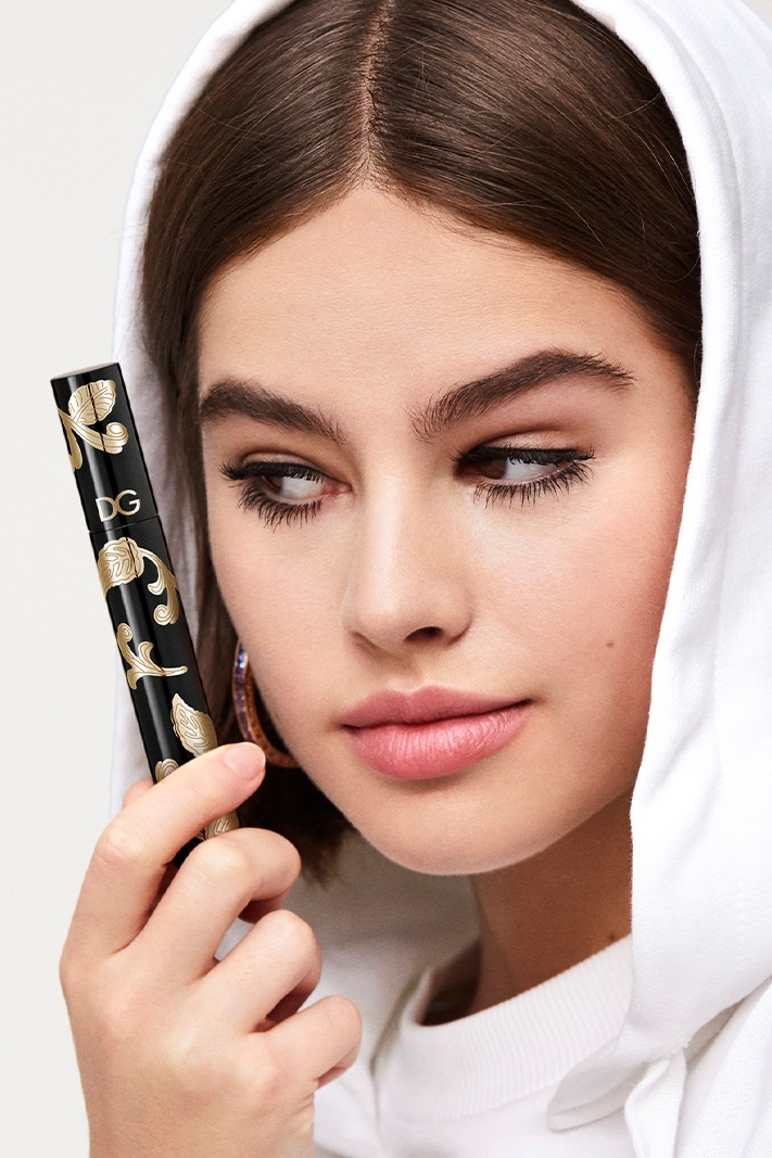 Model Lily Jean Harvey poses with Dolce & Gabbana Passioneyes Intense Volume Mascara
