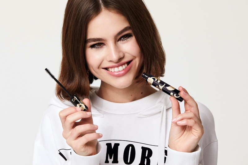 All smiles, Lily Jean Harvey poses with Dolce & Gabbana Passioneyes Intense Volume mascara